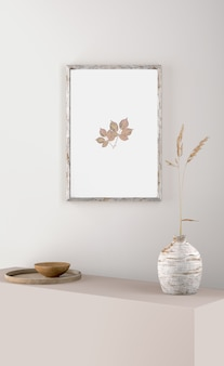 Frame on wall with flower in vase