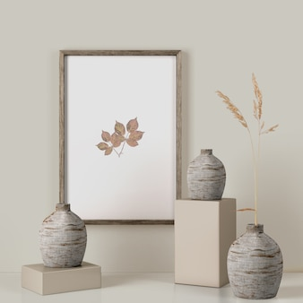 Frame on wall with leaves and vases