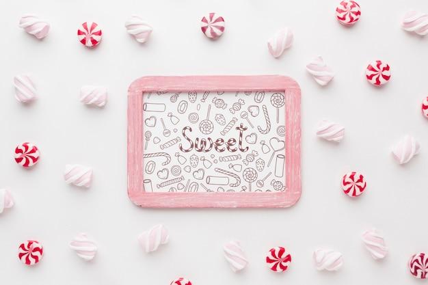 Рамка с вкусными конфетами рядом