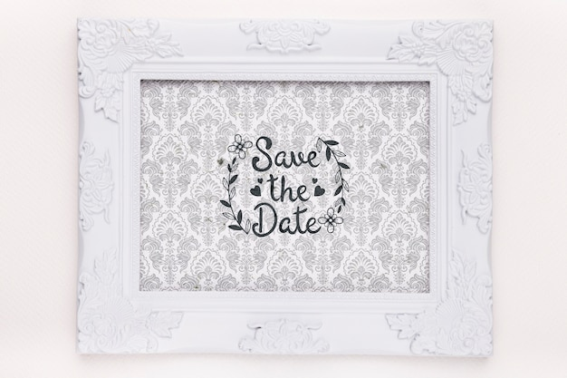 Frame with fancy tapestry save the date mock-up