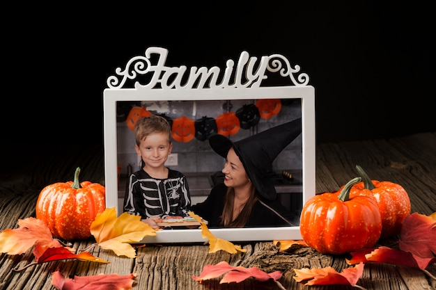 Frame with halloween picture and pumpkins