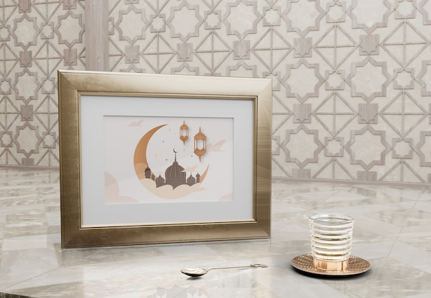 Frame with mosque picture and glass on marble table