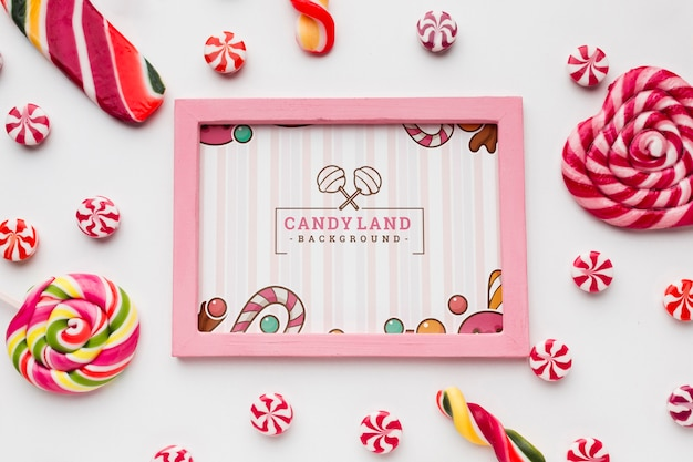 Frame with tasty candies beside