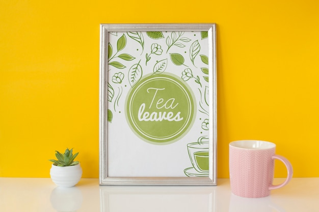 Frame with tea leaves concept
