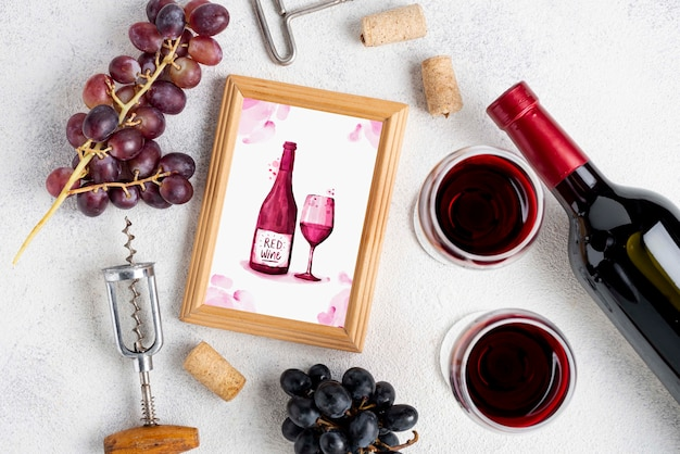 Frame with wine bottle on table