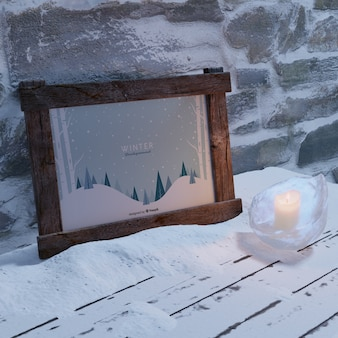 Frame with winter theme beside wall