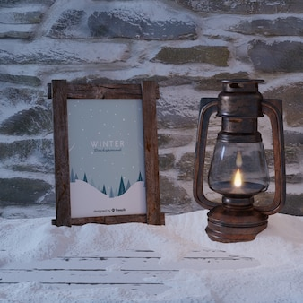 Frame with winter view beside lantern