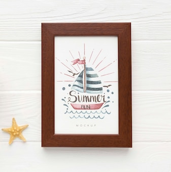 Frame on wooden background mock-up