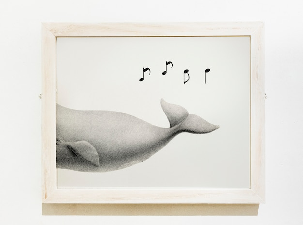 Framed art piece of a whale singing