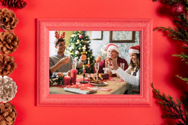 Framed family photo with pine cones