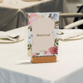 Framed reserved sign on the table