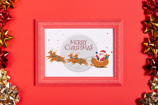 Framed santa and his reindeer photo with pull bows