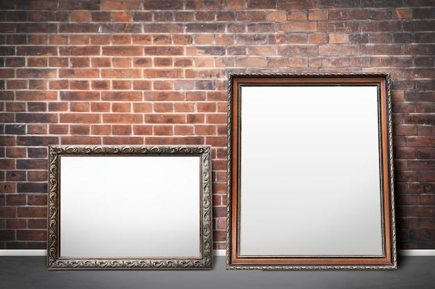 Frames by a brick wall