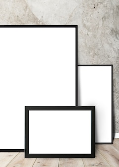 Frames leaning against a wall