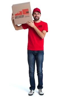 Uomo di consegna ininterrotto gratuito in piedi