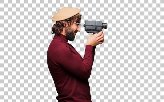 베레모와 빈티지 영화 카메라를 가진 프랑스 예술가