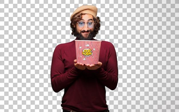 Французский художник с беретом держит ведро с попкорном