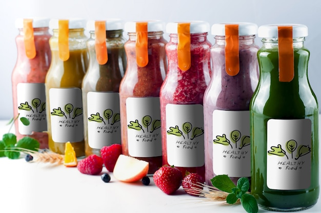 Fresh and healthy fruit and vegetable juices in glass bottle mock up