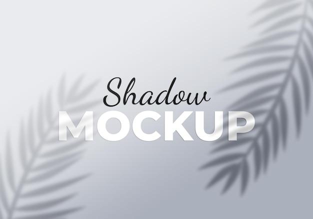 Fresh palm leaves shadow on beige