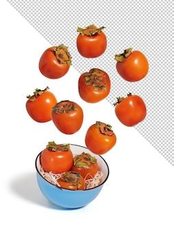 青いボウル、モックアップで飛んでいる新鮮な柿
