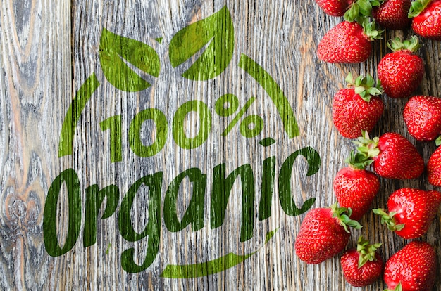 Fresh ripe strawberries on a wooden background. organic juicy berries.