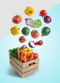 Fresh vegetables flying in a wooden box isolated