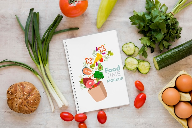 Fresh vegetables and notebook mock-up