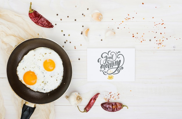 Fried eggs pan with red peppers