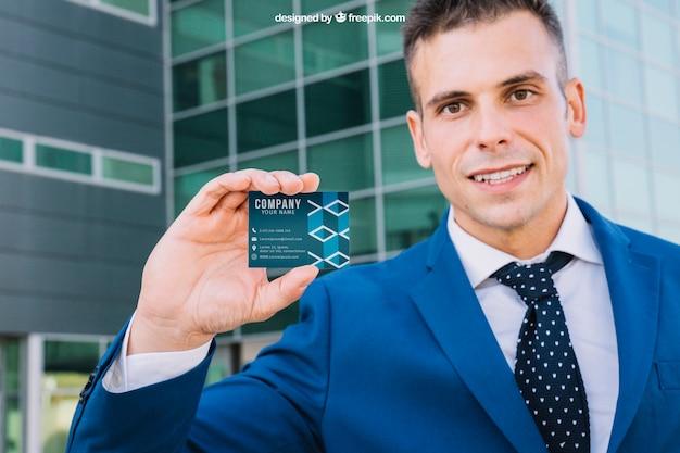 Friendly businessman presenting business card