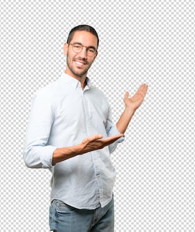 Friendly young man making a gesture of welcome