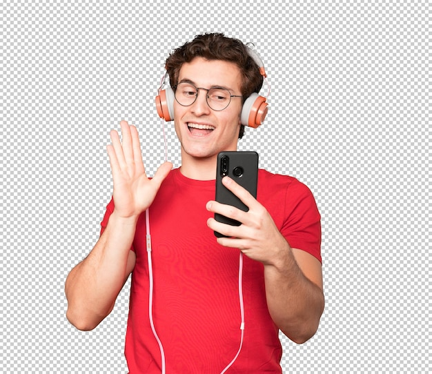 Friendly young man taking a selfie with his smartphone