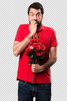 Frightened handsome man holding flowers