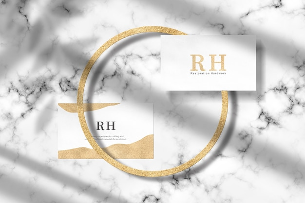 Front and back view gold business card mockup on marble floor
