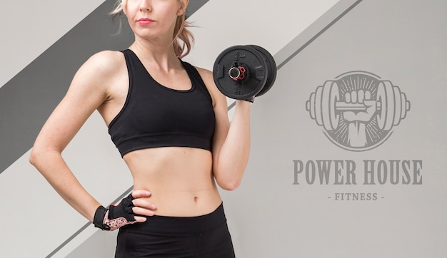 Front view of athletic woman holding weights