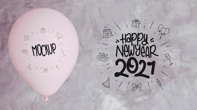 Vista frontale del mock-up di palloncini per felice anno nuovo