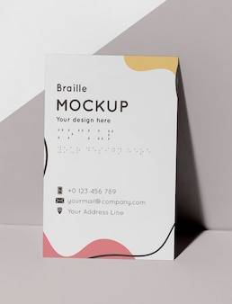 Front view of business card with embossed braille