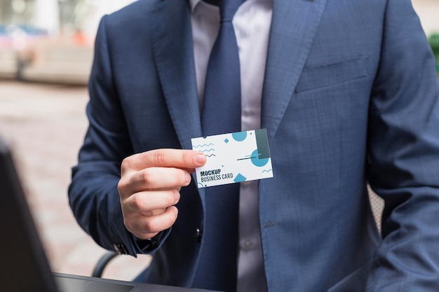 Front view of businessman holding business card