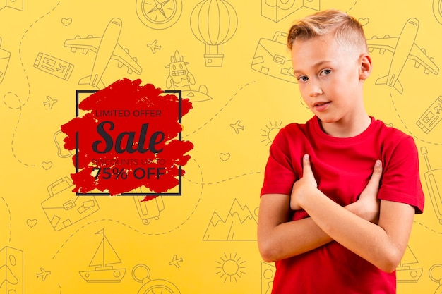 Front view of child posing with sale