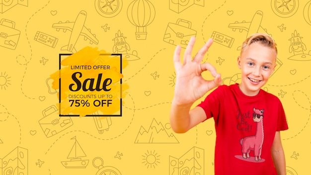 Front view of child smiling and giving thumbs up with sale