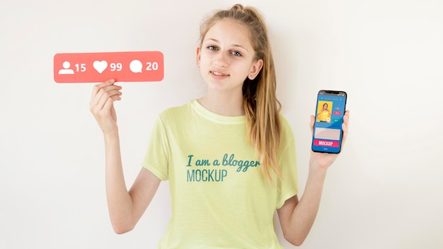 Front view of child vlogger with smartphone
