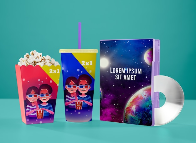 Front view of cinema cup with popcorn and dvd