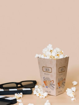 Front view of cinema popcorn in cup with copy space