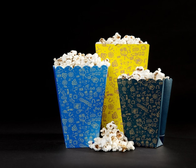 Front view of cinema popcorn cups