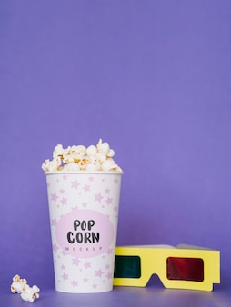 Front view of cinema popcorn and glasses