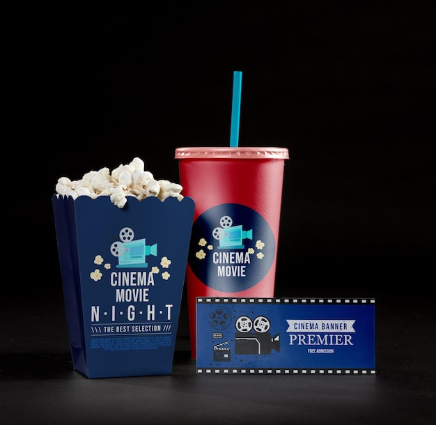 Front view of cinema popcorn with cup and card