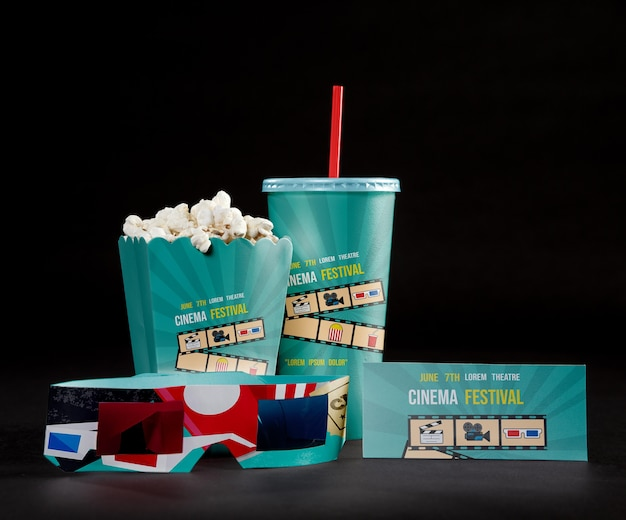 Front view of cinema popcorn with cup and threedimensional glasses