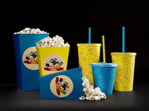 Front view of cinema popcorn with cups and straws