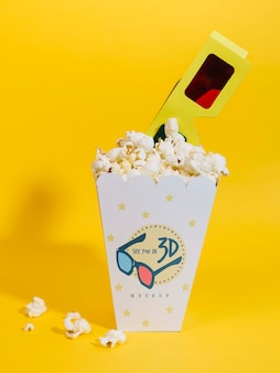 Front view of cinema popcorn with glasses