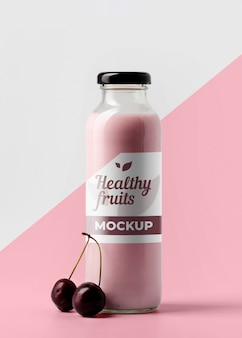 Front view of clear juice bottle with cherries