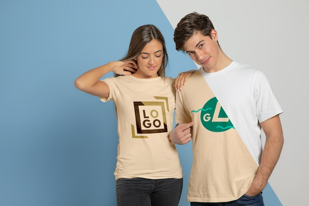 Front view of couple posing in t-shirts